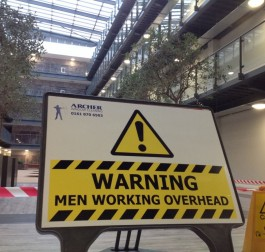 Archer Men Working Overhead signboard