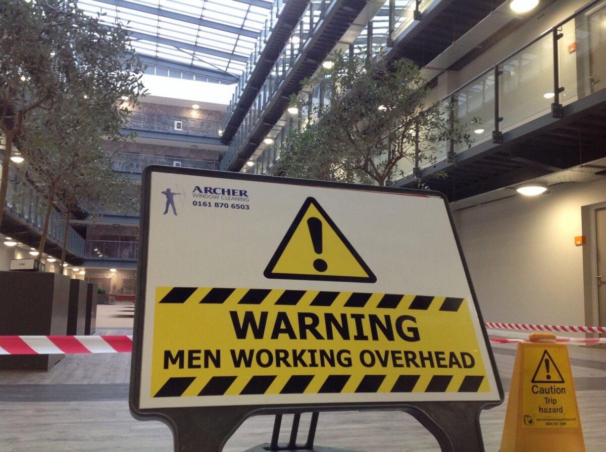 Archer Men Working Overhead signboard