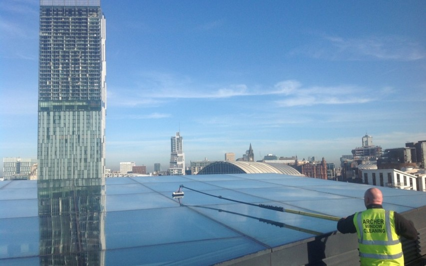 Atrium roof cleaning using reach & wash system