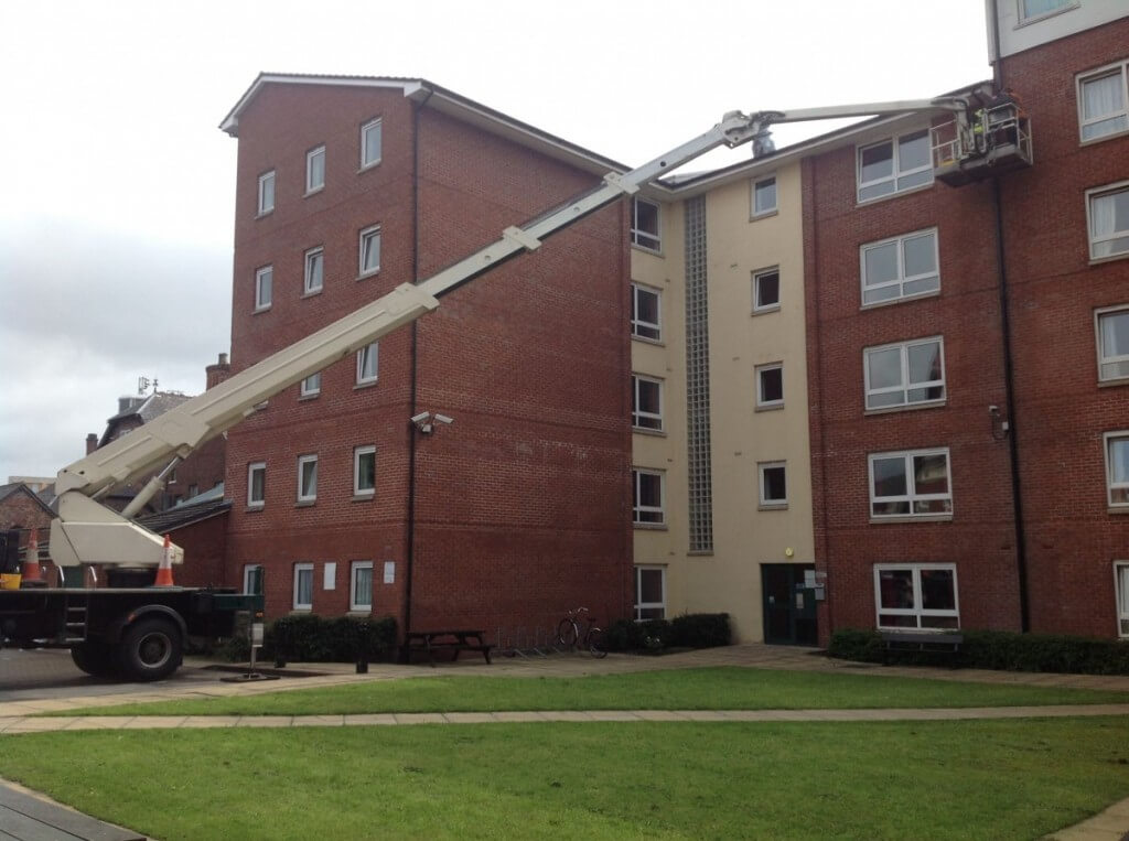 Apartment Building Gutter Cleaning using Cherry Picker