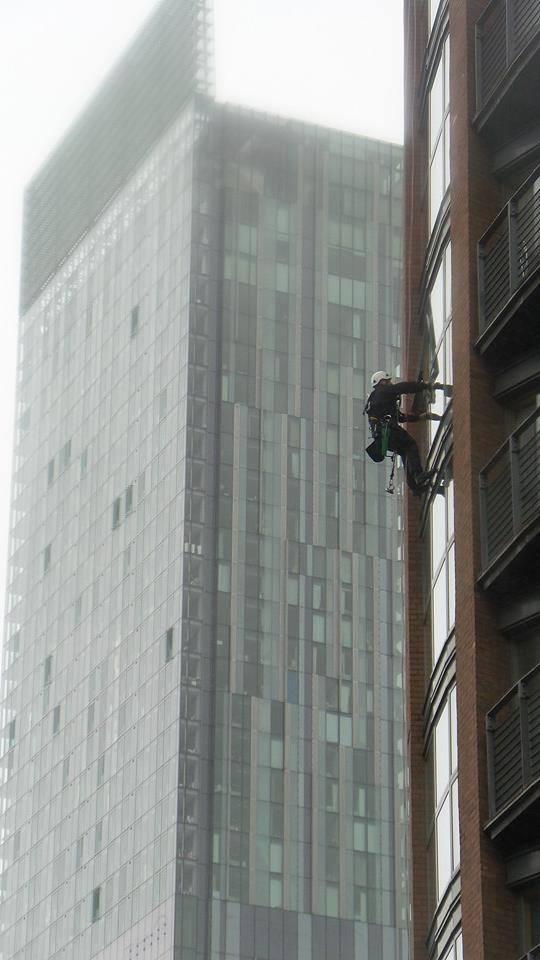 Abseiling window cleaners Deansgate Manchester