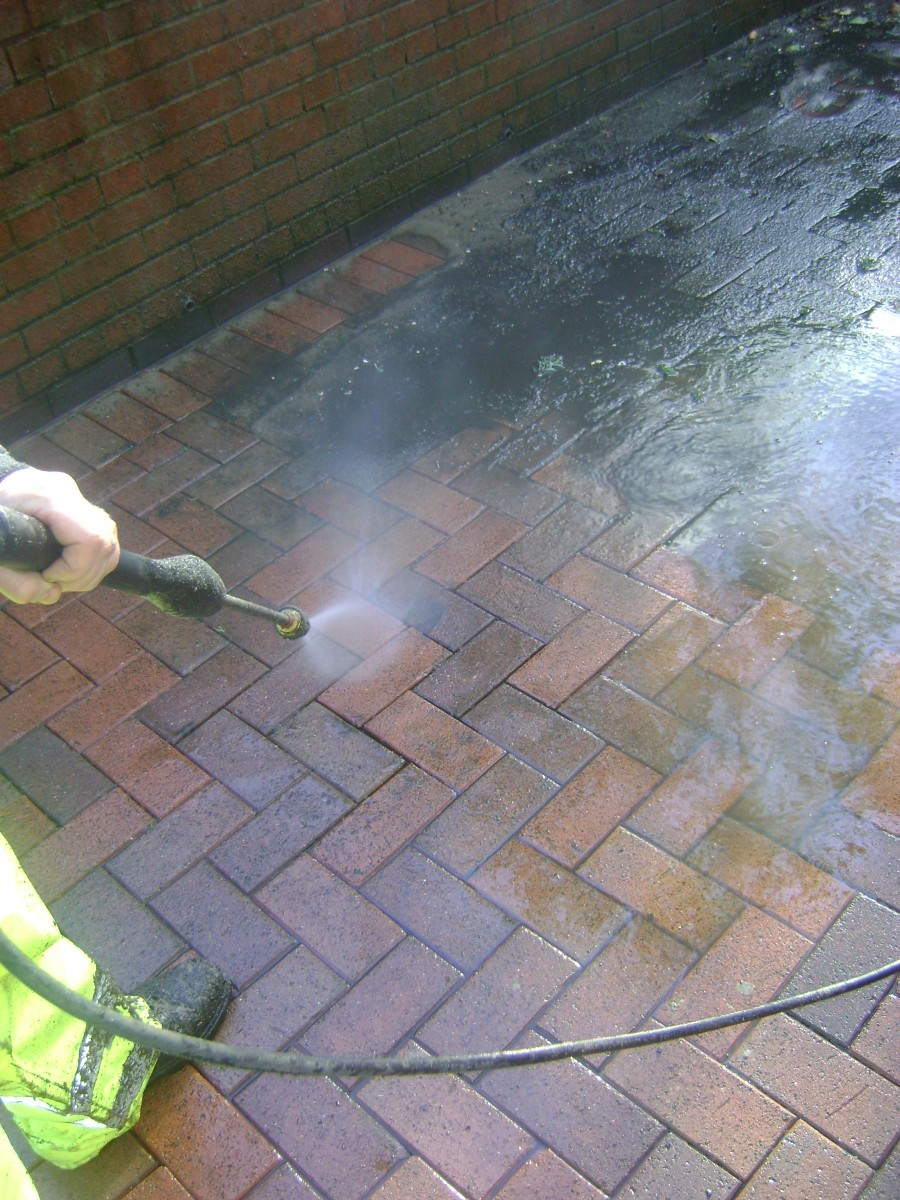 Jet washing floor tiles