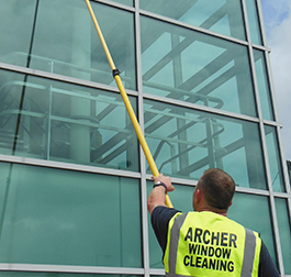 Commercial window cleaners Manchester with Waterfed pole system